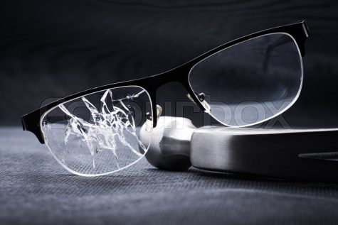 https://www.colourbox.com/image/broken-glasses-with-a-metal-mallet-on-black-background-image-29994630