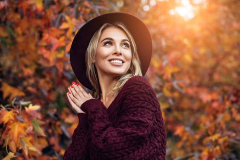 Beautiful woman enjoying a sunny autumn day